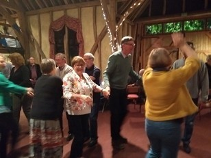 People dancing in the barn