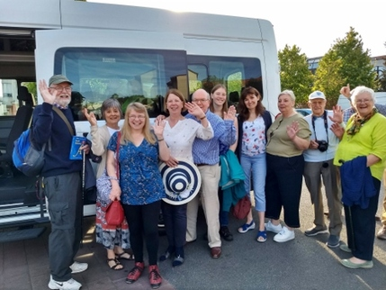 Twinning members posing by the minibus